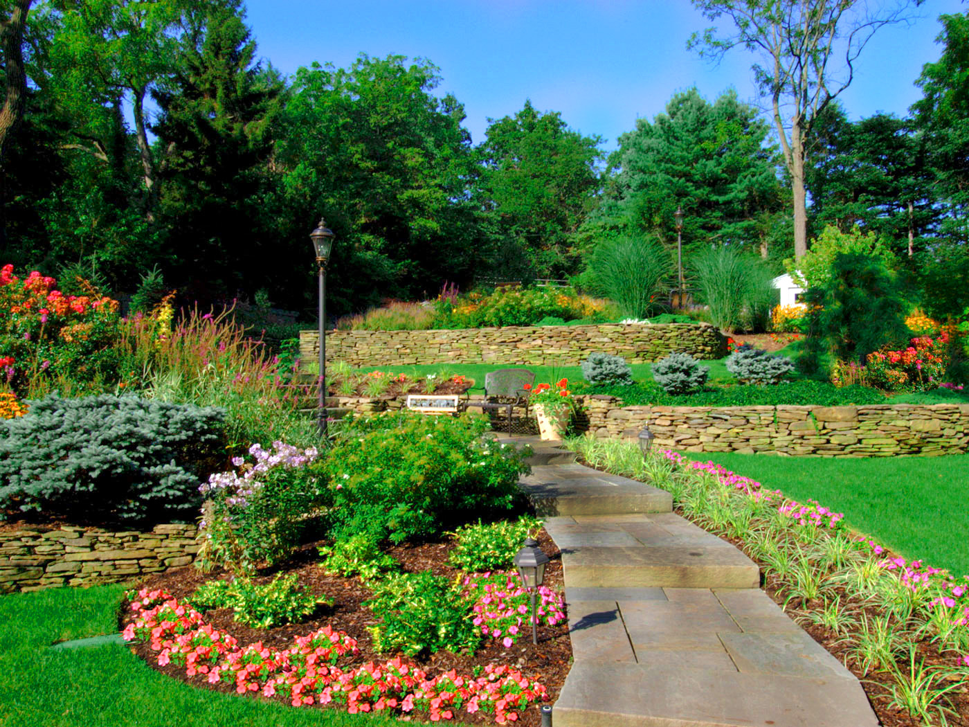 Rock gardens boulders and tree care with imported plants and stone in Oyster Bay Cove