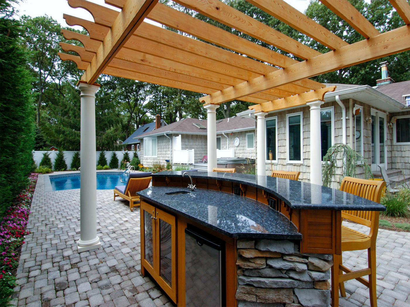 Outdoor pergola formal pool and outdoor kitchen landscaper near me South Hampton