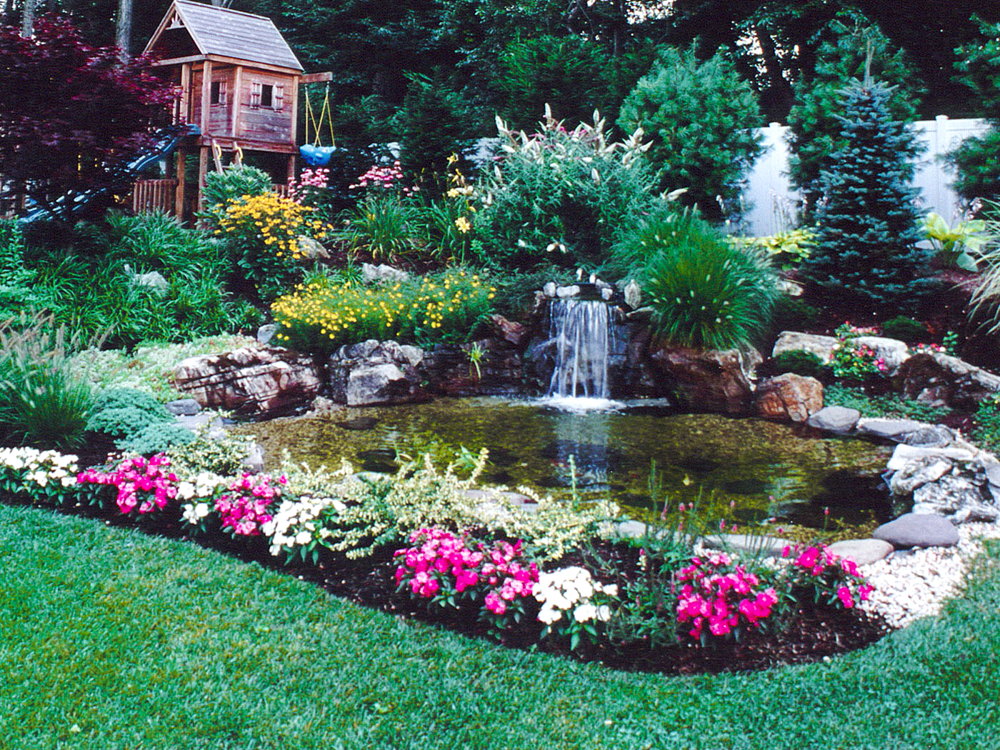 Fish pond in backyard and waterfall landscaper near me West Hampton