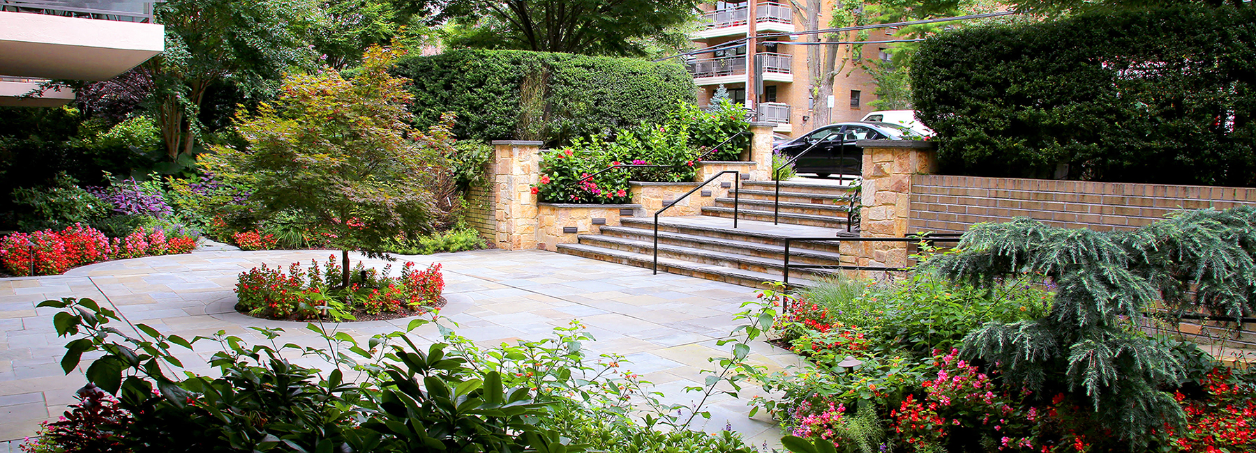 Bluestone patio with  entrance way stone steps and Japanese planting in Lloyd Neck