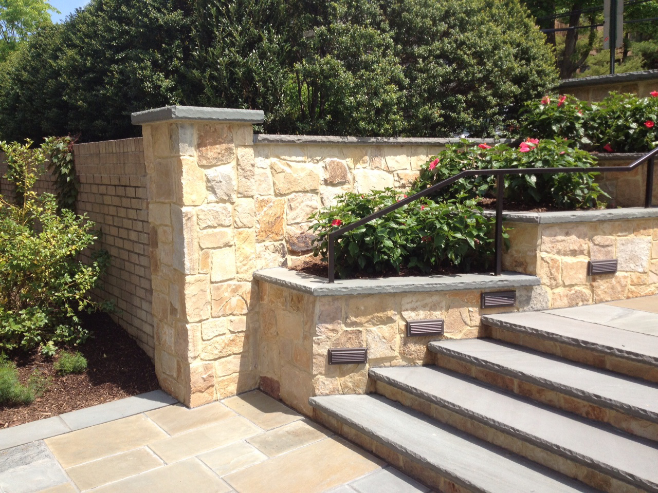 Bluestone staircase with stone retaining wall and colorful planting in Lloyd Neck