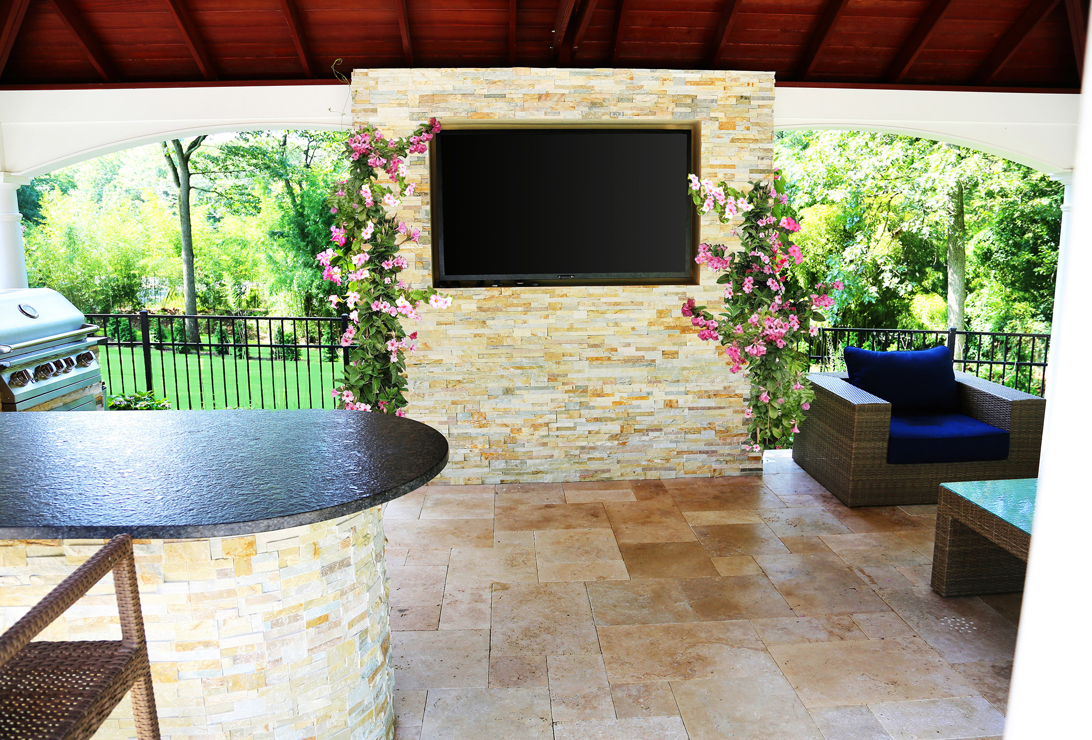 Outdoor kitchen and outdoor TV with grill, wet bar and custom stone patio in Smithtown