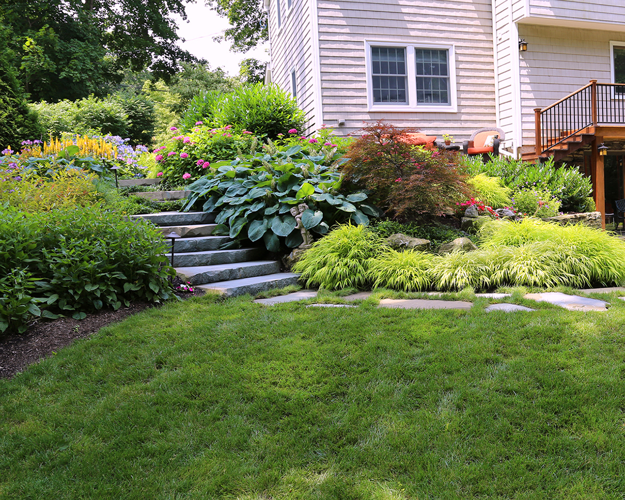 Natural stone steps and colorful planting landscapers near me in South Hampton